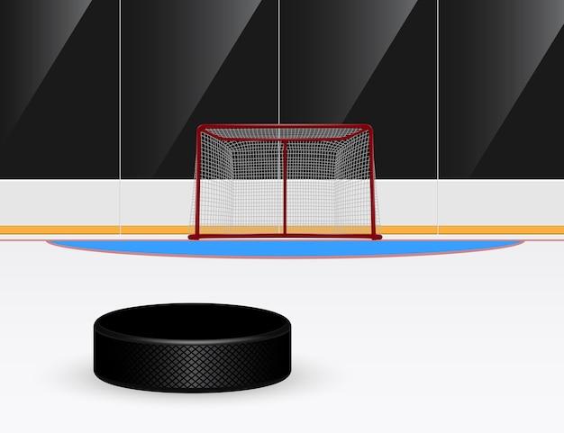 Ilustracja krążek hokejowy przed bramką