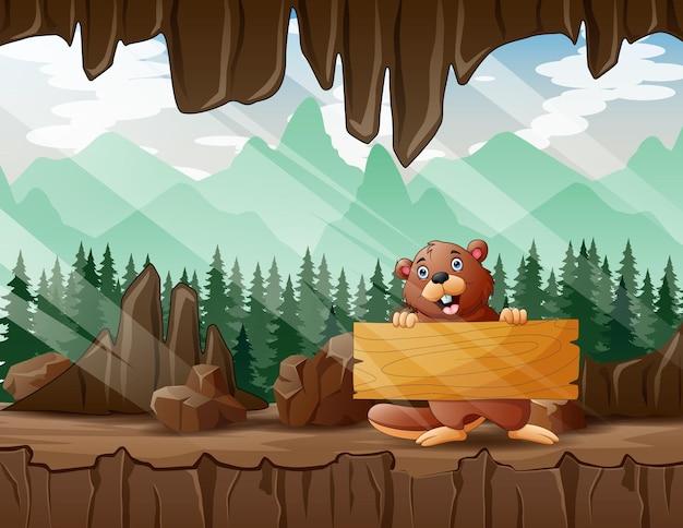 Ilustracja kreskówka bobra trzymającego drewniany znak w wejściu do jaskini