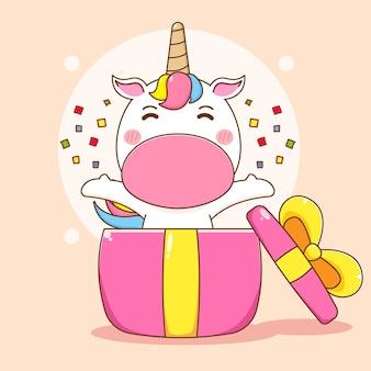 Ilustracja kreskówka słodkiej postaci jednorożca wyskoczyła z pudełka na prezent