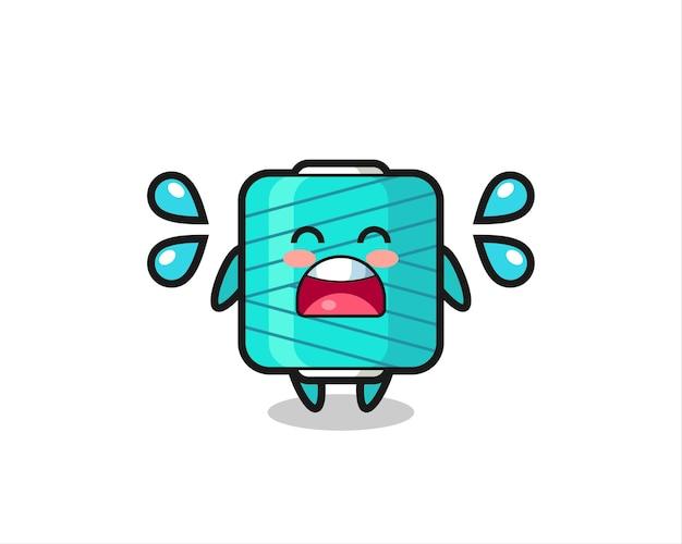 Ilustracja kreskówka szpuli przędzy z gestem płaczu, ładny styl na koszulkę, naklejkę, element logo