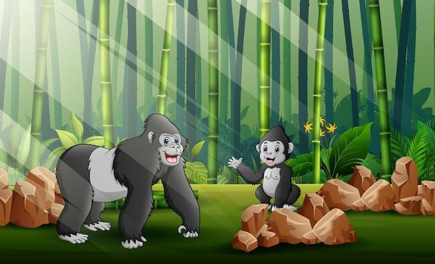 Ilustracja kreskówka wielkiego goryla z jej młode w tle lasu