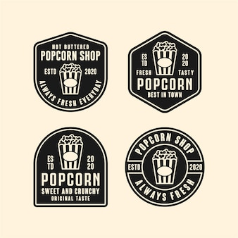 Ilustracja logo projektu sklepu popcorn na białym tle