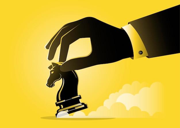 Ilustracja przedstawiająca dłoń biznesmena trzymającą kawałek szachowego rycerza, koncepcja strategiczna