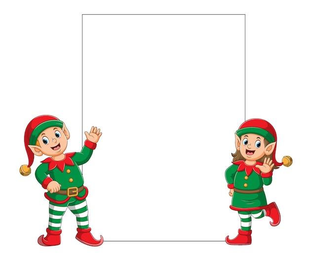 Ilustracja przedstawiająca dwa elfy w kostiumie klauna świętego mikołaja, stojących w pobliżu pustej tablicy