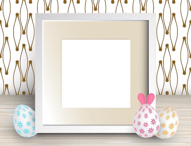 Ilustracja realistyczna ramka kwadratowa i pisanki. biała pusta ramka na zdjęcia
