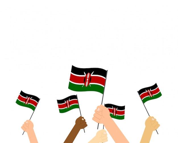 Ilustracja ręce trzymając flagi kenii