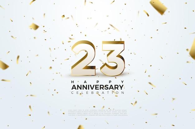 Ilustracja rozrzuconej złotej folii na tle 23. rocznicy