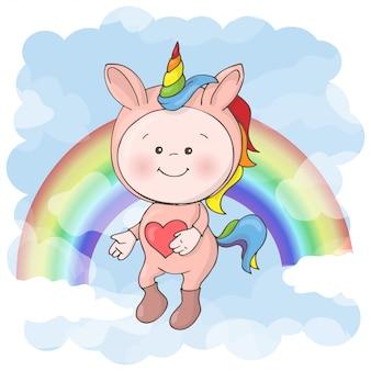 Ilustracja śliczny dziecko w jednorożec kostiumu. styl kreskówki.