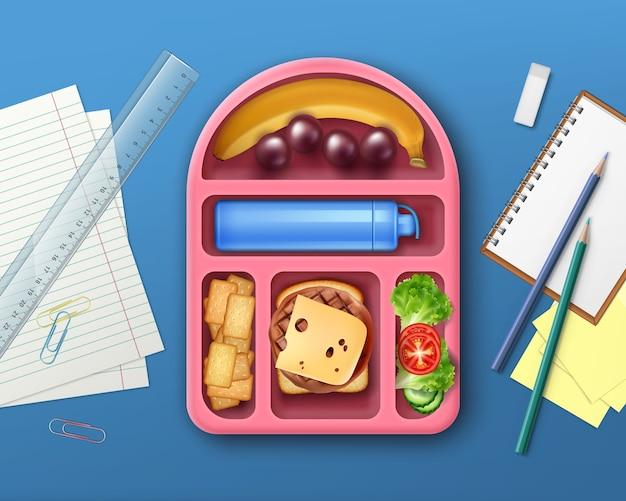 Ilustracja szkolnego pudełka na lunch z owocami