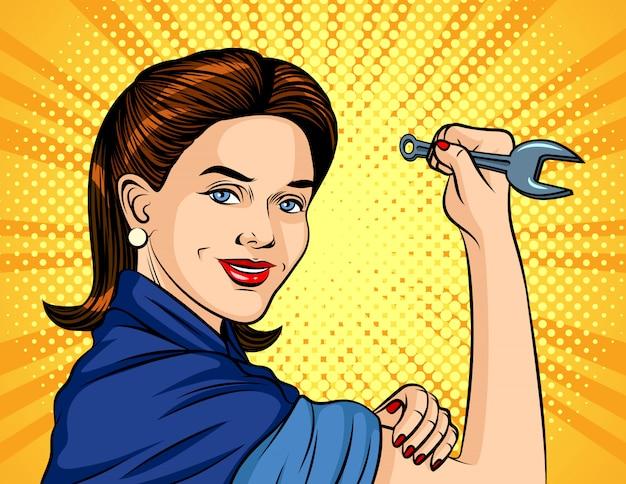 Ilustracja w stylu pop-art. kobieta z kluczem w ręku. miedzynarodowy dzień pracy. piękna kobieta w formie roboczej trzyma klucz