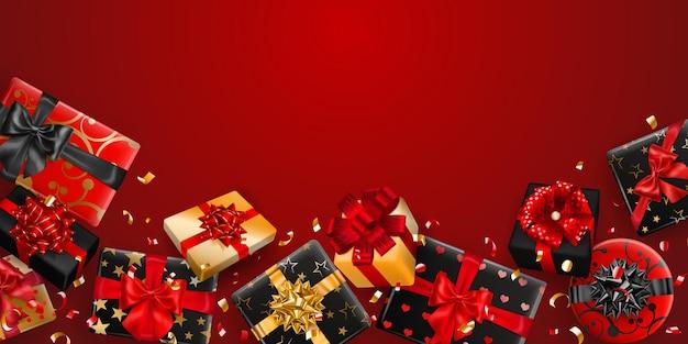 Ilustracja wektorowa czarnych i złotych pudełek prezentowych z wstążkami, kokardkami i cieniami oraz małymi błyszczącymi kawałkami serpentyny na czerwonym tle