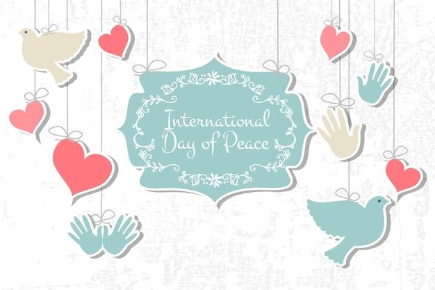 Ilustracja wektorowa międzynarodowy dzień pokoju. płaska konstrukcja stylu ikony dzień pokoju. odznaki dnia pokoju z gołębiem, sercem, ręką. szablon dnia pokoju na pocztówkę, zaproszenie, druk