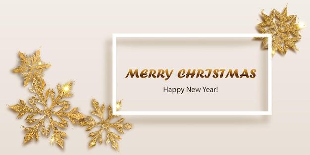 Ilustracja wektorowa piękne błyszczące złożone świąteczne płatki śniegu wykonane z błyszczy w złotych kolorach i białej ramce z cieniem i napisem na jasnym tle