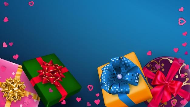 Ilustracja wektorowa wielobarwnych pudełek prezentowych ze wstążkami, kokardkami i cieniami oraz małymi serduszkami na niebieskim tle