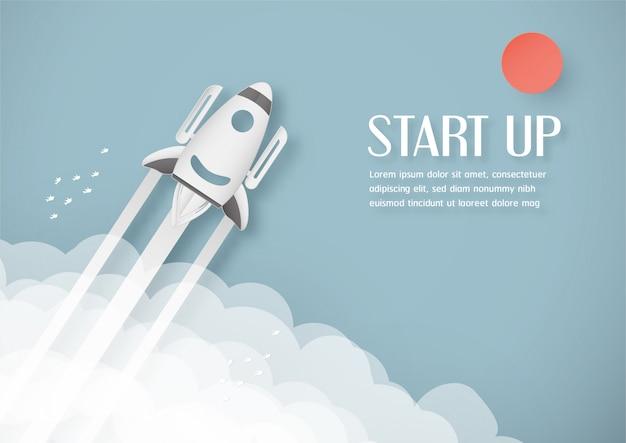 Ilustracja z koncepcją uruchomienia w stylu cięcia papieru, rzemiosła i stylu origami. rakieta leci na błękitnym niebie.