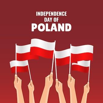 Ilustracja z okazji święta niepodległości polski. ręce z flagami polski