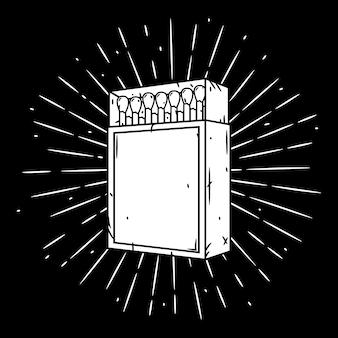 Ilustracja z pudełkiem zapałek i rozbieżnymi promieniami.