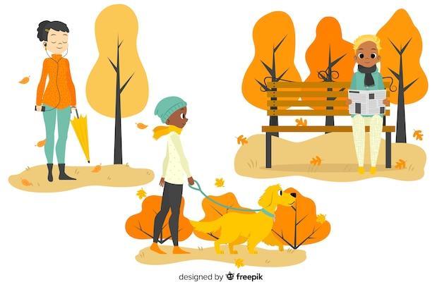 Ilustrowani ludzie w parku jesienią
