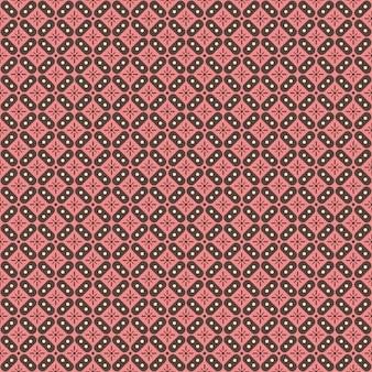 Indonezyjski batikowy wzór z różnymi motywami tradycyjnej kultury javanese, batik kawung w brązowo-różowej kolorystyce, może być stosowany na całą tkaninę