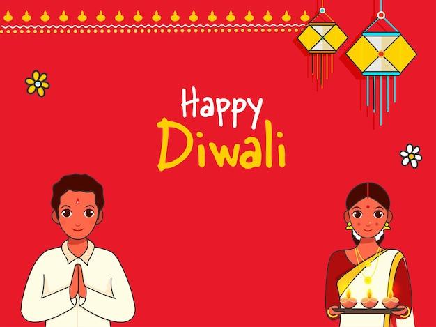 Indyjska para robi namaste (witamy) i trzymać płytkę lampę naftową (diya) z okazji happy diwali celebration.
