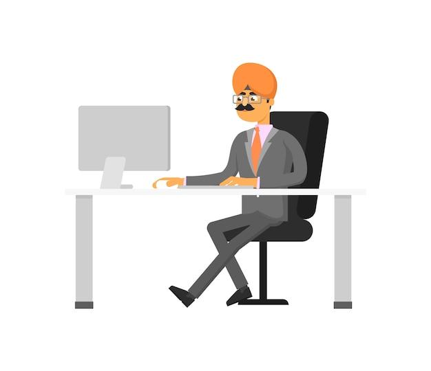 Indyjski biznesmen pracuje na komputerze