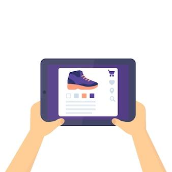 Internetowy sklep obuwniczy, kup trampki, tablet w rękach