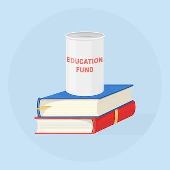 Inwestowanie pieniędzy w fundusz edukacyjny. stos książek z pudełkiem oszczędnościowym