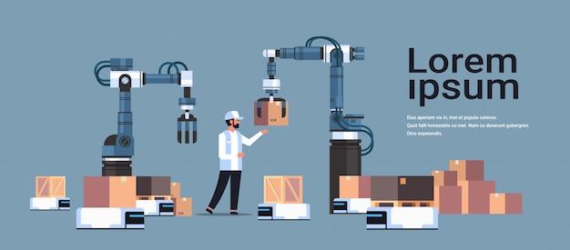 Inżynier człowiek kontrolujący roboty ręce