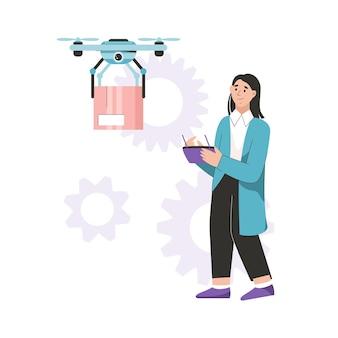 Inżynier kontroluje drona dostarczającego paczkę z tekturowym pudełkiem