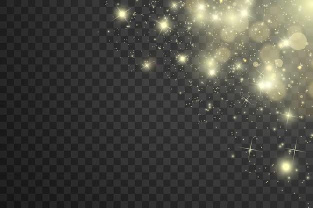 Iskry i złote gwiazdy błyszczą specjalnym efektem świetlnym. błyszczy na przezroczystym tle. boże narodzenie abstrakcyjny wzór. lśniące, magiczne cząsteczki kurzu.