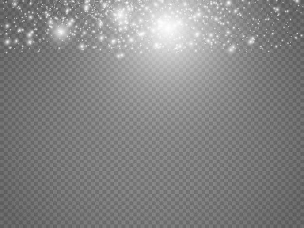 Iskry kurzu i złote gwiazdy lśnią specjalnym światłem. wektor błyszczy na przezroczystym tle. świąteczny efekt świetlny. błyszczące magiczne cząsteczki kurzu.