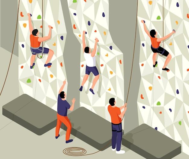 Izometryczna kompozycja wspinaczkowa z widokiem na ścianę treningową z linami oraz postaciami instruktorów i ilustracją szkoloną