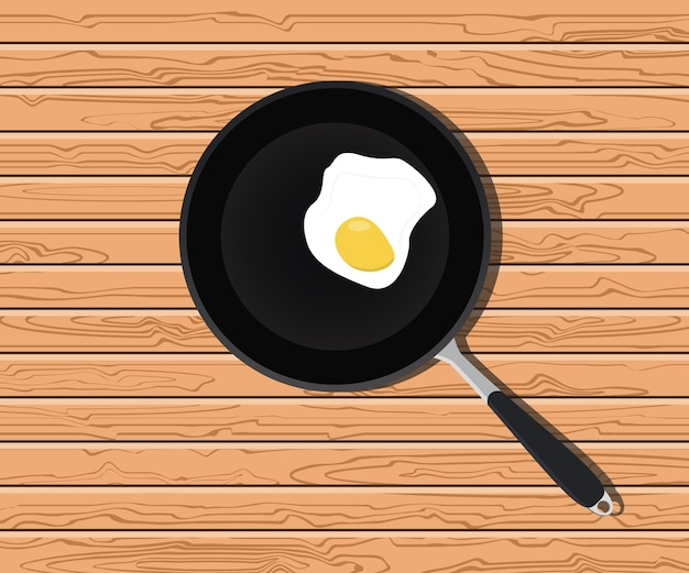 Jajeczny pogodny na dłoniak niecce z drewnianym stołem