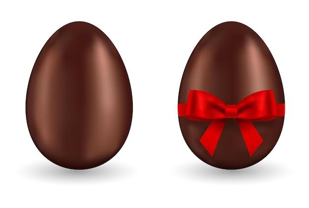 Jajko Czekoladowe Z Czerwoną Kokardą 3d Na Białym Tle Premium Wektorów