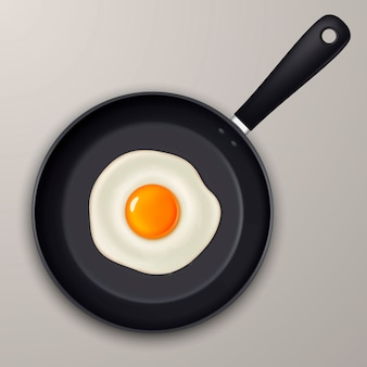 Jajko sadzone na czarnej patelni. realistyczna ikona.