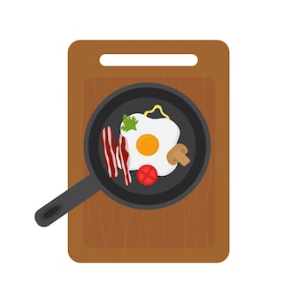 Jajko sadzone na patelni z warzywami na desce do krojenia
