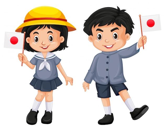Japońska dziewczyna i chłopiec trzyma flagę
