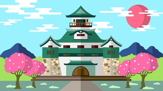 Japoński zamek tenshu z drzewami i chodnikiem