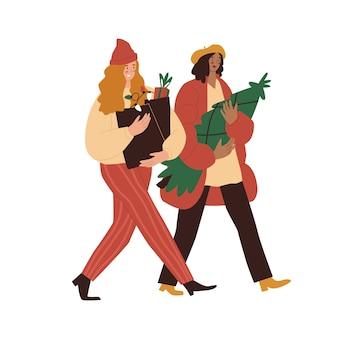 Jarmark bożonarodzeniowy ludzie kupujący choinki na targu dwie kobiety przygotowują się do nowego roku