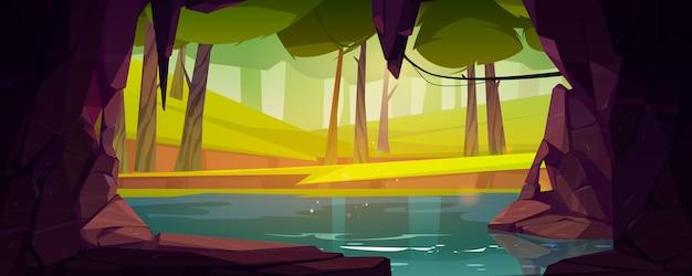 Jaskinia w skale z jeziorem i lasem na zewnątrz wektor kreskówka letni krajobraz z kamiennym wejściem do jaskini...