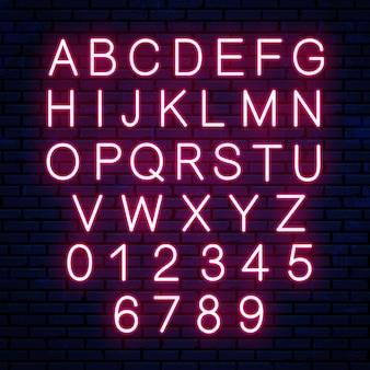 Jasne neonowe litery na białym tle. neonowa czerwona czcionka, alfabet