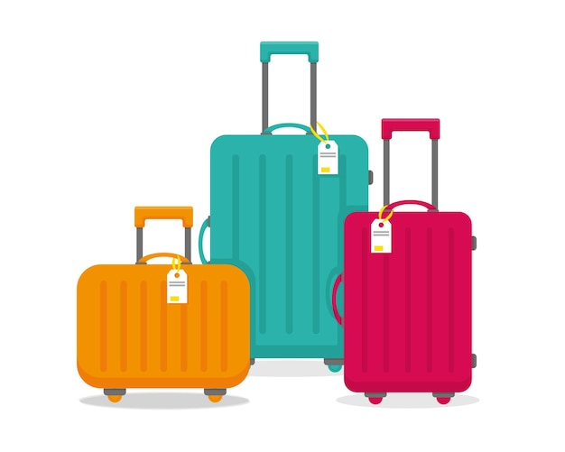 Jasne walizki podróżne na białym tle