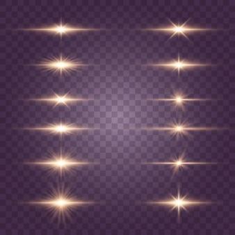 Jasne złote błyski i odblaski. jasne promienie światła. złote światła na białym tle