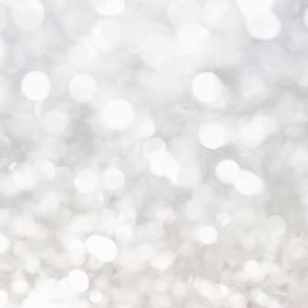 Jasny srebrny brokat światła bokeh w tle