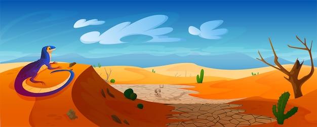 Jaszczurka siedzi na wydmie na pustyni ze złotym piaskiem