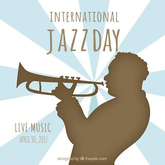 Jazz dzień tła z trębaczem sylwetce