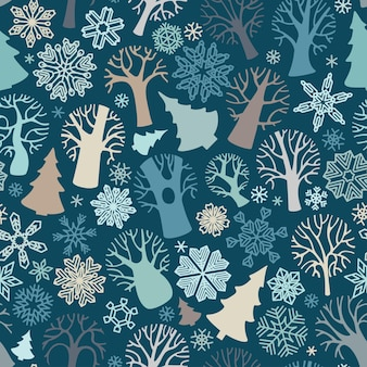 Jednolity wzór drzew i płatków śniegu na ciemnoniebieskim tle