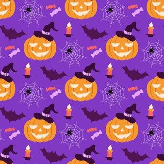 Jednolity wzór halloween z dynią w kapeluszu i pajęczynami nietoperze i słodycze