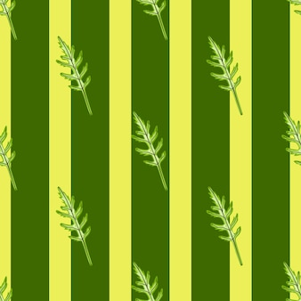 Jednolity wzór kilka sałatka z rukoli na paski żółte tło. nowoczesna ozdoba z sałatą.