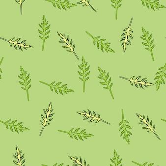 Jednolity wzór kilka sałatka z rukoli na pastelowym zielonym tle. nowoczesna ozdoba z sałatą.